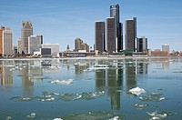Canada, Ontario, Windsor. March 2010. Detroit and the Detroit River with flowing ice as seen from Canada during the spring thaw