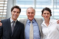 Portrait of confident business people standing together in office