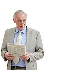 Senior businessman with a newspaper looking at copyspace isolated against white background