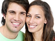 Closeup portrait of smiling young couple in love on white background