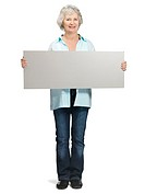 Portrait of a retired old female holding blank bill board