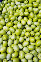 Green olives at a market, Italy.