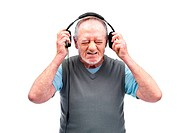 Senior man expressing loud sound over the headphones against white background