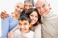 Closeup portrait of a cheerful multi generational family smiling together