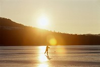 One person long_distance skiing at sunset, Sweden.
