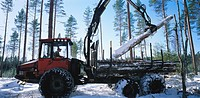 Tractor loading timber