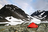 A tent in front of a glacier, Lapland, Sweden.