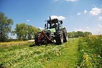Deutz tractor mowing a Spring Meadow in Bavaria