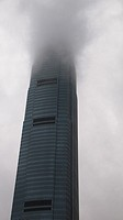 IFC tower in Hong Kong covered with clouds.