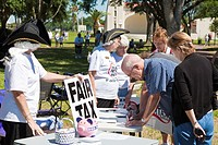 Eustis, FL - Apr 2009 - Concerned citizens signing Fair Tax petitions at a Tea Party political event at Farran Park in Eustis, Florida