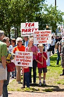 Eustis, FL - Apr 2009 - Family of three generations carry protest signs at a Tea Party political event at Farran Park in Eustis, Florida