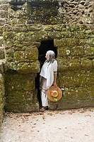 Guatemala, Tikal, Shaman in temple doorway