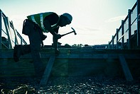 Silhouette of a Workman using a hammer