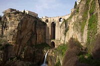 Ronda, Andalusia, Spain, The Bridge With A Waterfall And Rock Cliffs