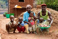 Family showing vegetables grown in garden, Rwanda