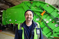 Pacific Islander man standing by garbage truck