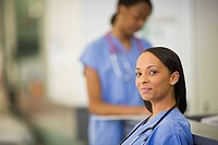 Smiling Black nurse in scrubs