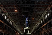 Businessman on platform in warehouse