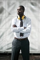 Businessman with ear defenders