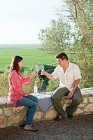 Young romantic couple with wine