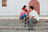 Young couple sitting on steps (thumbnail)