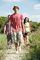 Young friends walking along rural path