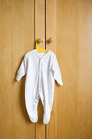 Babygro hanging on wardrobe