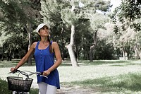 Woman with a bike in a park