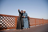 Middle Eastern people and fence, outdoors (thumbnail)