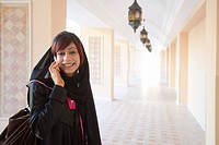 Middle Eastern woman using mobile phone