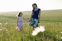 Woman and child in sunny meadow