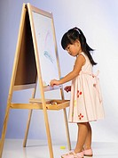 Girl drawing on whiteboard