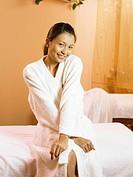 Woman with bathrobe in spa salon