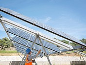 Spanish solar power station with worker