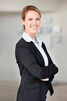 Happy confident business woman in suit