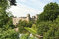 Warwick Castle is a medieval castle in Warwick, the county town of Warwickshire, England  It sits on a cliff overlooking a bend in the River Avon