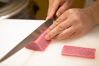 Hand slicing tuna