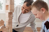 Father and son playing with building blocks