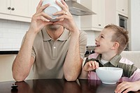 Father and son eating cereal together (thumbnail)