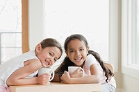 Little girls with mugs