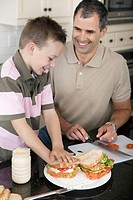 Father and son making sandwiches