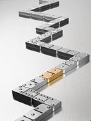 Gold domino in line of silver dominoes (thumbnail)