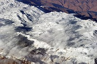 Aerial view of a snowcaps in a mountain range