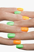 Woman with brightly painted finger nails