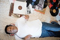 Man listening to records on headphones