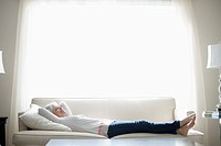 Woman laying on sofa (thumbnail)