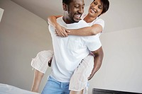 Man giving wife piggyback ride