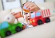 Boy playing with toy trucks