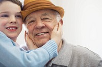 Boy touching his grandfather's face
