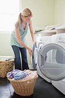 Woman washing laundry